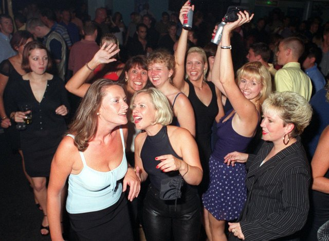 Revellers dancing the night away at Buddies 25+ nightclub at The Pyramids Centre, Southsea.