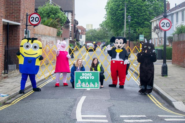 St Jude's Primary school is trialling the SusTrans school streets initiative. Characters in fancy dress welcoming children to school with Safeguarding manager, Hannah Chainey with Head Teacher, Rachael Osbourne at St Nicholas Street, Portsmouth. Picture: Habibur Rahman