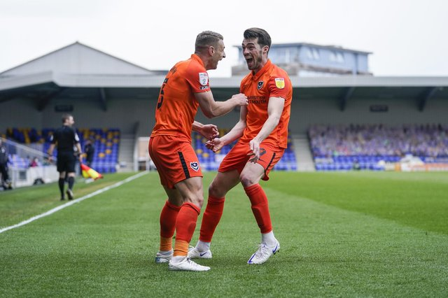 John Marquis rushes to congratulate Lee Brown following his second goal.