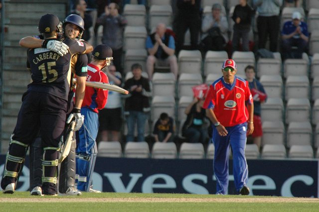 Michael Lumb celebrates with Michael Carberry after hitting Hampshire's first ever T20 century against Essex in June 2009. Picture: Rob Atkins