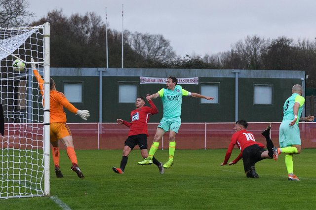 Calum Benfield heads Fareham into the lead against Roman Glass. Picture: Keith Woodland