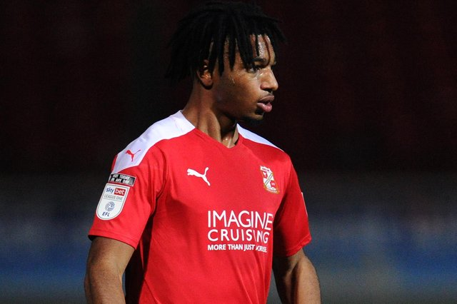 Akin Odimayo, on trial at Pompey, in action for Swindon last season. Picture: Alex Burstow/Getty Images