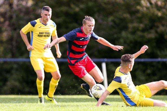 Zak Willett (red/blue) has scored 80 goals in just 36 appearances for Paulsgrove and Southsea United this season.  Picture: Chris Moorhouse