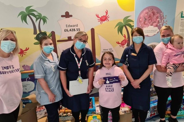 India-Rose Jenkins, 6 from Hilsea, delivered toys and chocolates to Queen Alexandra Hospital after raising £1,200 through a walking challenge. Pictured: India-Rose handing over the donations to staff from Starfish ward, accompanied by nanny Pauline Jenkins, mum Chantelle Jenkins and little sister Sofia-Mae