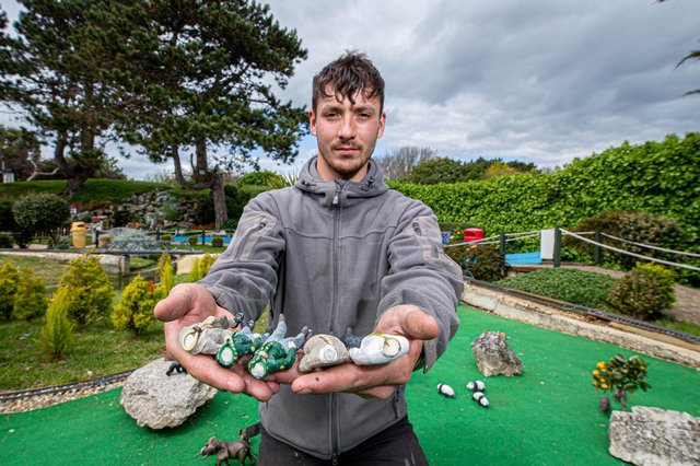 Assistant manager, Harry Wilson with some of the damaged miniature figures at Southsea Model Village. Picture: Habibur Rahman