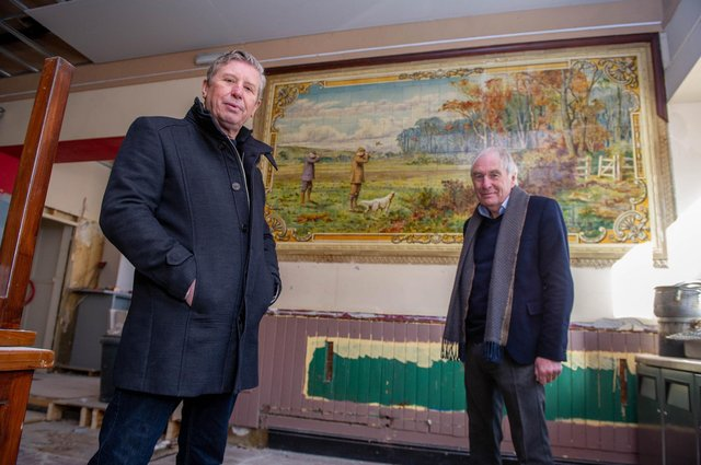 Owners of the pub, Mick Forfar and Steve Kingsley in front of a historic tile artwork uncovered during the venue's refurbishment. Picture: Habibur Rahman