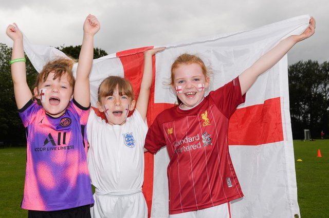 Stubbington Youth FC teams supporting England in the Euro 2020Pictured is: Elisa, Olivia and Mia cheer on England.Picture: Keith Woodland (110721-25)