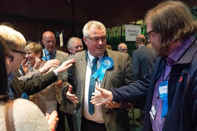 Cllr Geoff Fazackarley (centre), after being elected as Conservative councillor for Fareham South.  Picture Credit: Keith Woodland