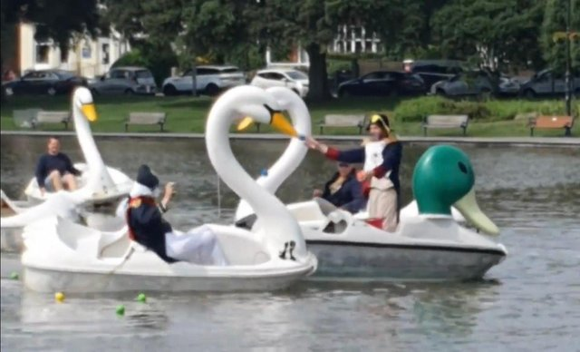 The battle of Canoe Lake - Comedian Al Murray, left, throws a ball at First Dates' host Fred Sirieix, right, from his swan-shaped pedalo in Canoe Lake. Photo: Instagram/Grayinpompey