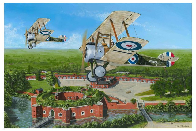 With Fort Brockhurst far below we see a pair of Sopwith Camel biplanes banking overhead. Picture: Neil Marshall