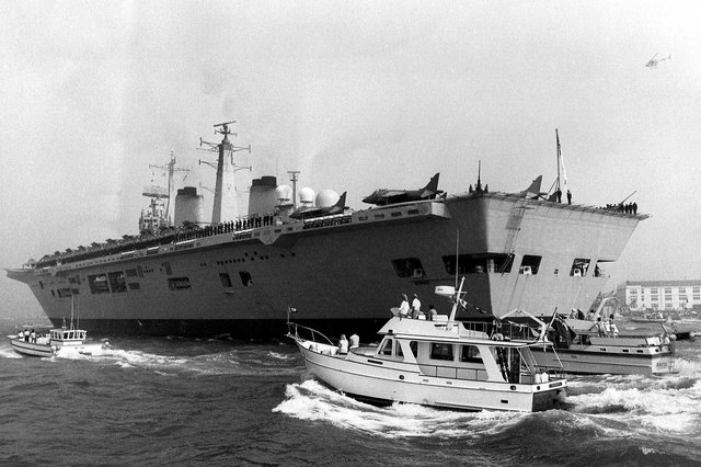 Journey over -  HMS Invincible receives a heroine's welcome as she enters Portsmouth Harbour on her return from the Falklands war, September 1982.