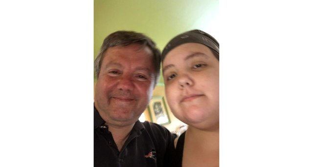 Shaun Peters and his daughter Irene, who he has been caring for