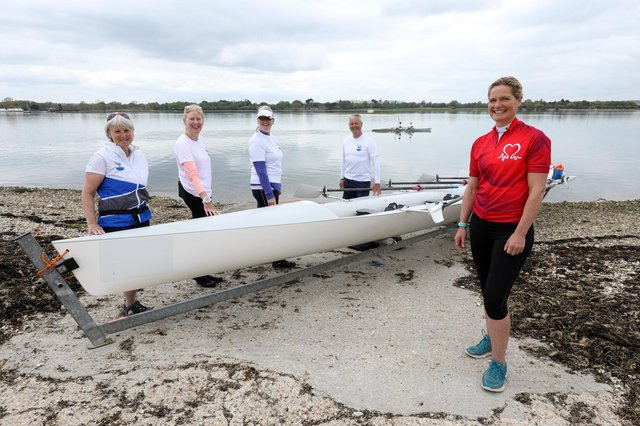 Dr Sophie Bostock, in red, is training to row around the UK in June in aid of the British Heart Foundation. She is pictured along with, from left, Julia Rooke, Andi Davies, Dee Pullen and Andrew Ferrand, at Dolphin Rowing Club, Northney Marina. Picture: Chris Moorhouse (jpns 140521-10)