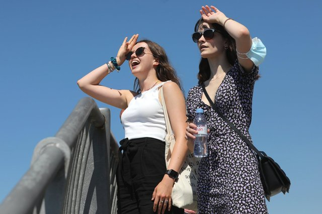 Two walkers look to the sea during the weekend's hot weather in Old Portsmouth.