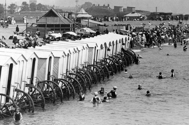 1900:  Holidaymakers enjoying mixed bathing at Southsea, with a line of bathing machines along the shore. Picture: Getty Images