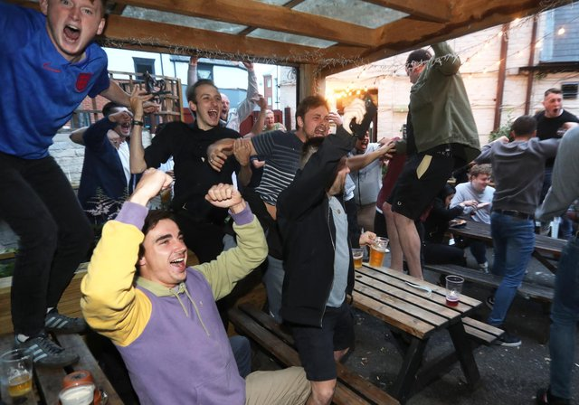 Fans at the Milton Arms in Portsmouth watching England play Denmark in the Euro 2020 semi-finals at Wembley. Picture: Sam Stephenson