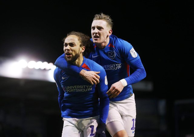 Marcus Harness and Ronan Curtis celebrate during Pompey's EFL Trophy success over Exeter in February 2020. But Wembley selection could be hinder by regulations. Picture: Joe Pepler