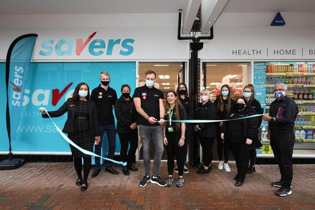 Manager Reece Webber cuts the ribbon, backed by the staff. Opening of Savers, High St, GosportPicture: Chris Moorhouse (jpns 180621-01)