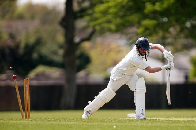 Portsmouth Community's Matt Davies is bowled during his side's win over Hayling Island. Picture: Chris Moorhouse