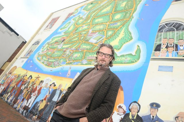 Artist Mark Lewis pictured in front of the Strand mural on the junction of Waverley Road and Clarendon Road in Southsea.  Picture: Sarah Standing (171120-8684)