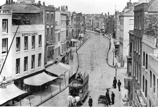 This wonderful shot taken from the top of the Square Tower is of High Street, Old Portsmouth, as it looked before the Luftwaffe changed it forever. In fact it was taken before the First World War. All the buildings on the left were destroyed, an area that is now part of Cathedral Green. The clock tower of the cathedral can be seen peeking over the rooftops, top left.