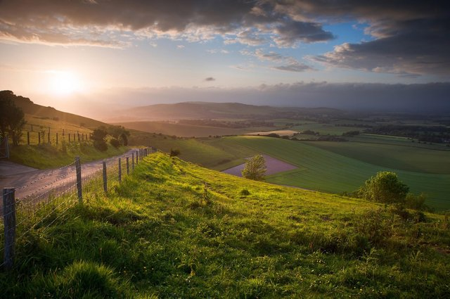 Sunset over rolling English countryside in the South Downs National Park