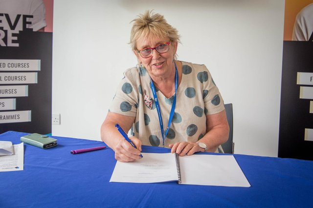 Pictured: Penny Wycherley, principal of Highbury College signing the official papers at Highbury College, Portsmouth.  Picture: Habibur Rahman