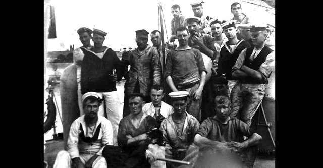 After coaling ship. Ships were all powered by furnaces. Here we see some of the crew from the turtle-back destroyer HMS Chamois.  Bottom centre of the photograph is the ship's pet and to the left of it is George Harwood. He was the grandfather of George Millener who loaned us the photographs. Picture: George Millener collection