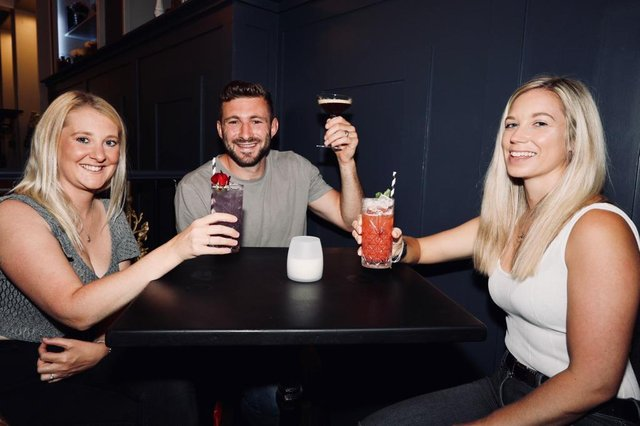 From l to r - Katie and Liam Perkins, and Alice Hosker, drinking in the Monarch in 2020. Picture: Chris Moorhouse