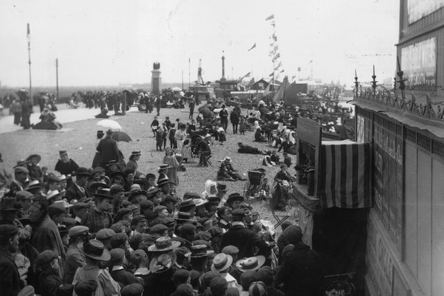 Crowds watching a Punch and Judy show at Southsea, about 1895. Picture: Hulton Archive/Getty Images.