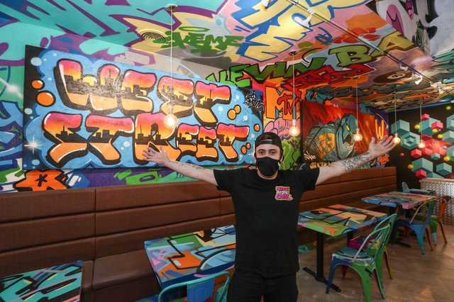 A look inside Bangerz 'n' Burgerz a new restaurant in Havant which has been decorated by local and international graffiti artists. General manager Ellis Bloy pictured in the new restaurant. Picture: Stuart Martin (220421-7042)