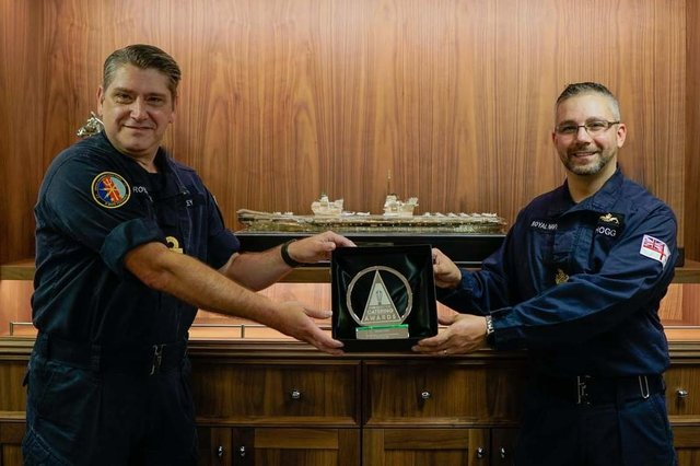 Warrant Officer 1 Sam Hogg, right, pictured with Rear Admiral Mike Utley picking up his award. Photo: Royal  Navy