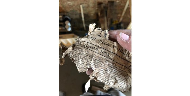 Newspaper from the 19th century was found in the walls during the renovation. Picture: Drift