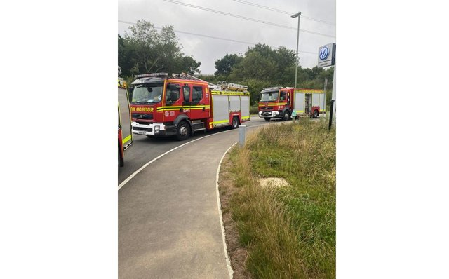 Three fire engines attended the scene to stage a controlled venting of a package leaking an unknown gas.