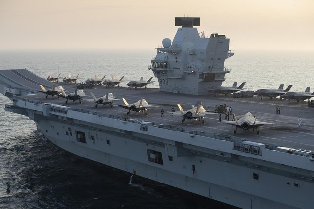 HMS Queen Elizabeth pictured with both US and UK F-35 stealth jets embarked on board. Photo: Royal Navy