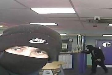 Masked robbers pictured attempted to raid the Coral betting shop in Gosport. Photo: Hampshire police