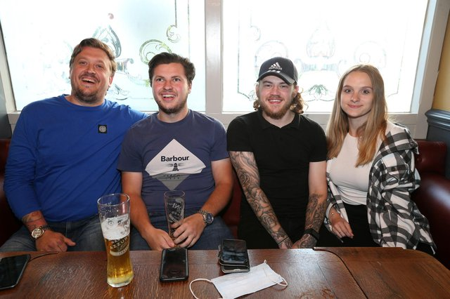 From left, Sam Sharp, Jake Binding, Ethan Mortimer and Jessica Watt. Fans watch England v Czech Reublic in England's third Group D game of Euro 2021, in The Star & Garter pub, Copnor, Portsmouth Picture: Chris Moorhouse (jpns 220621-20)