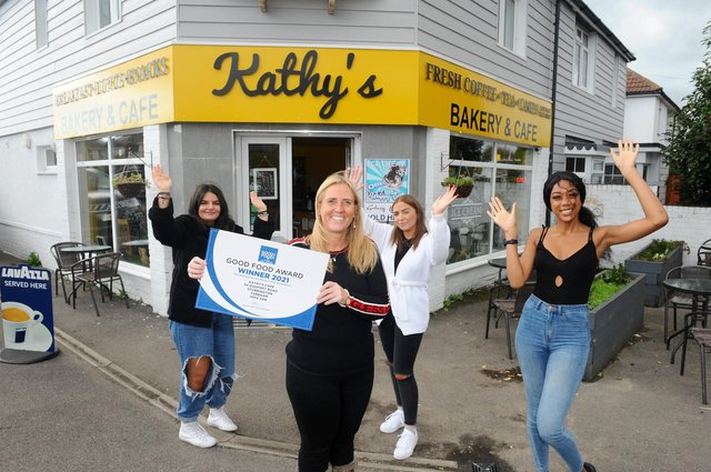 Second left, Kathy Wingate, owner of Kathy's Cafe with her team (l-r) Iustina Vasilescu, cafe assistant, Mia Chambers, manager, and Yasmin Lourenzo, cafe assistant, with their award as Overall Cafe Winner from the Good Food Awards. Picture: Sarah Standing (091020-5223)