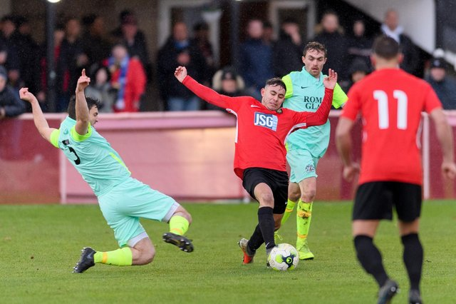 Jack Breed stretches for the ball during Fareham Town's FA Vase win against Roman Glass St George in December at Cams Alders. Picture: Keith Woodland