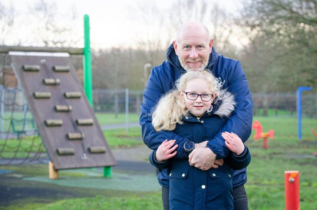 George 'Topsy' Turner pictured with his daughter Harriet, six, at Emsworth Park play area on 6 January 2020  Picture: Habibur Rahman